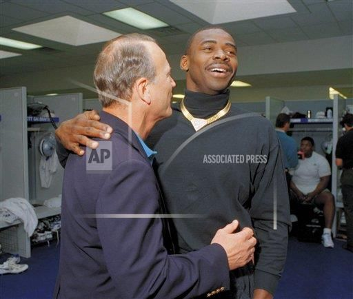 Dallas Cowboys wide receiver Michael Irvin puts his arm around head coach Barry Switzer in the Cowboys locker room on Friday, April 29, 1994 in Irving, Texas, on the first day of the Cowboys mini-camp. Switzer, meeting with some 30 veterans the day after he was hired, saw Irvin storm out of the room.