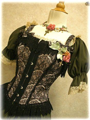 "fuckyeaherololita: "" Excentrique corset over a dress by Schwarz Schmetterling. """