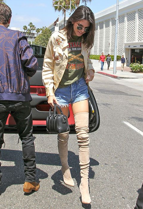 Sand-coloured OTK boots and a matching patchwork jacket make Kendall's slogan T-shirt and Daisy Dukes 'fit everything