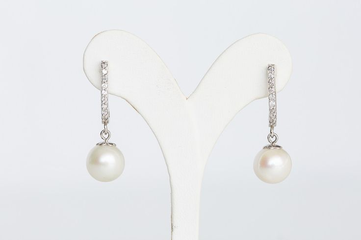 Earrings from Pearl with silver and zircon- Price:54.00€