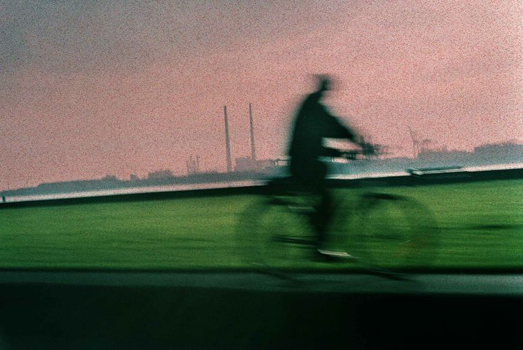 From somewhere in my past a man on a bicycle whizzes past, on the strand in Clontarf, Dublin.