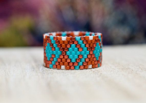 RING DESIGN: Indian Summer - Ring B  This is a beaded ring made with the peyote stitch. The ring is made with tiny glass beads and polyethylene thread. It is custom made to order and does NOT stretch. The width is approximately .47 of an inch.  Ring sizes: 4 to 14 U.S. (see below)  ***THE RING MUST FIT LOOSE ENOUGH TO SLIDE ON AND OFF EASILY WITHOUT TUGGING. ***ORDER ONE FULL SIZE LARGER THAN YOU NORMALLY WEAR IN A METAL RING.  Each bead is approximately 1/16th of an inch wide. The sizes...