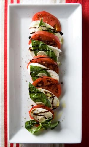 Caprese is my most favorite salad! I make mine simpler than this recipe with just mozzarella, tomatoes, fresh basil and glazed balsamic that I reduce myself. MM!