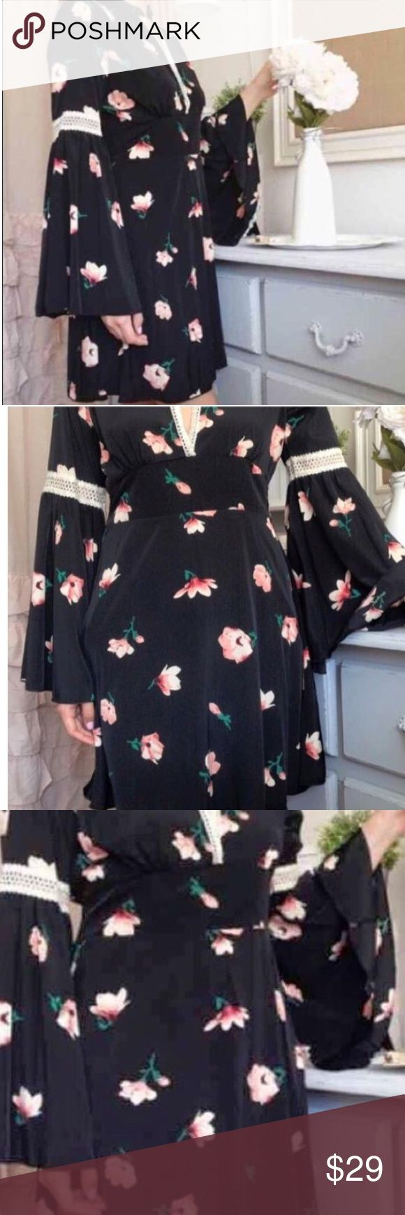 Brand New Gorgeous Bell Sleeve Dress Size Large This dress is stunning !! Black floral print with crochet detail and bell sleeves • Size Large • Fits Size 10 to 12 Comfortably Poly rayon blend🌸 Free Shipping on all orders of $40 or more including bundles !! Be sure to comment so I can set up a separate listing just for you to reflect the shipping discount 😊🌸😊 Dresses