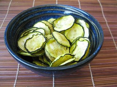 Zucchini Chips ~ Slice the zucchini into thin rounds. Add the rounds in a bowl and toss with the olive oil, salt and pepper. Place each round on the dehydrating sheet, flat and separated. You don't want them to overlap or they won't dry properly.   Turn the dehydrator on to 135 or 140ºF and let them dry for 4-5 hours, until they're nice and crispy.   Serve with guacamole, bean dip, hummus, you name it. Or eat them plain, as is. They're delicious no matter what