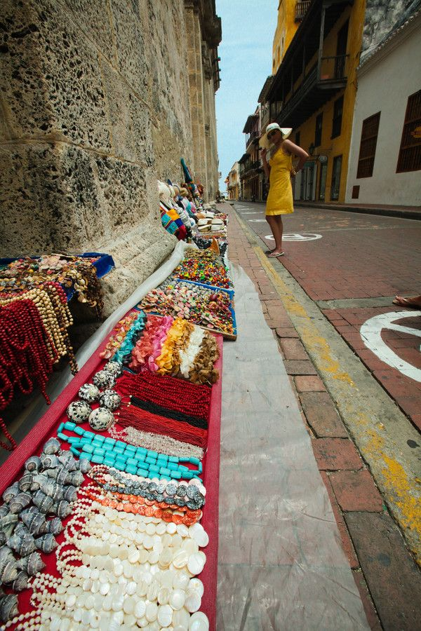 Street Shopping - Cartegena, Colombia. They literally chase you down the street with whatever you look at!