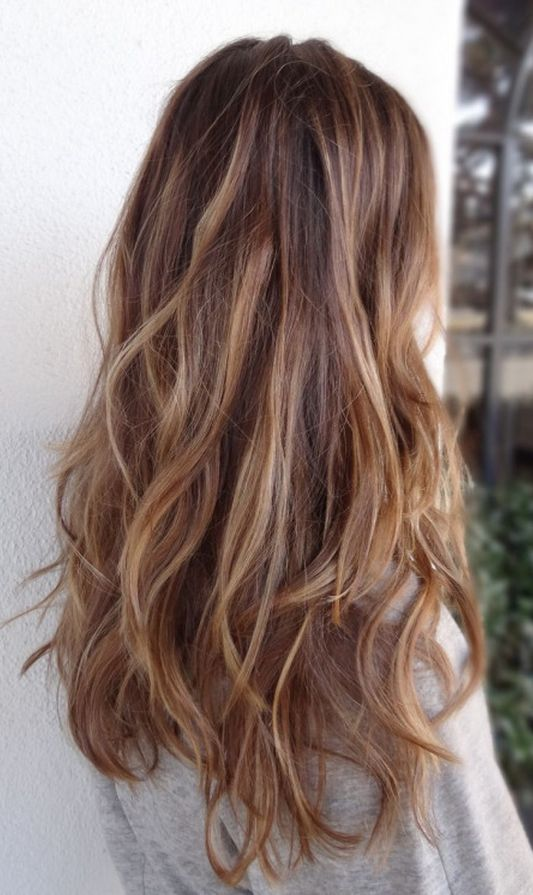 Gorgeous long wavy layers with caramel highlights. We're in love.