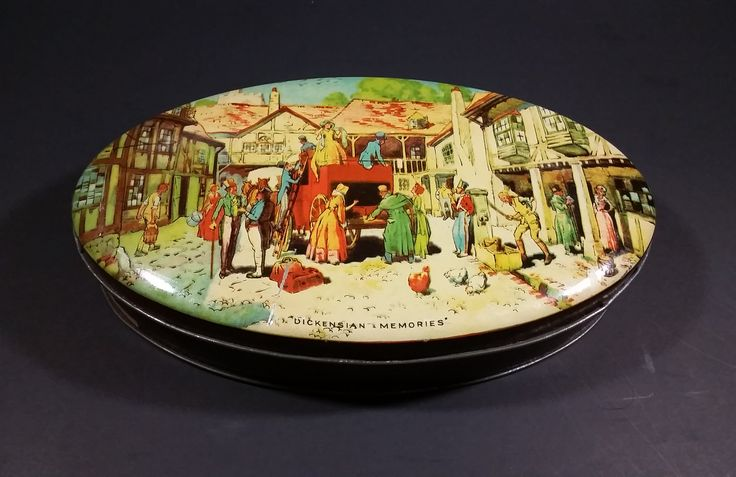 """Vintage 1950s Riley's Toffee """"Dickensian Memories"""" Village Scene Tin - E.I & co. ltd Shipley England https://treasurevalleyantiques.com/products/vintage-shipley-1950s-rileys-toffee-dickensian-memories-village-scene-tin-e-i-co-ltd-shipley-england #Vintage #1950s #50s #Fifties #RileysToffee #Toffee #Sweets #Candies #Caramels #Candy #VintageTins #CharlesDickens #Dickensian #Memories #Villages #Scenes"""