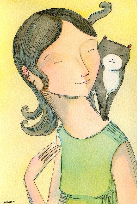 Mujer y gatito gris y blanco