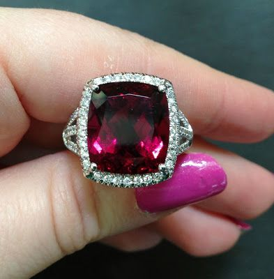 A large garnet and diamond ring by Coast Diamond.  Via Diamonds in the Library.