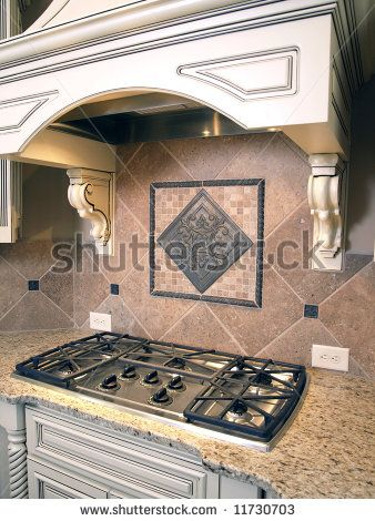Granite color Luxury Kitchen Cooktop Burners with Ornate Hood by Anthony Berenyi, via ShutterStock