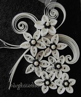 White flowers quilled on black background :-)