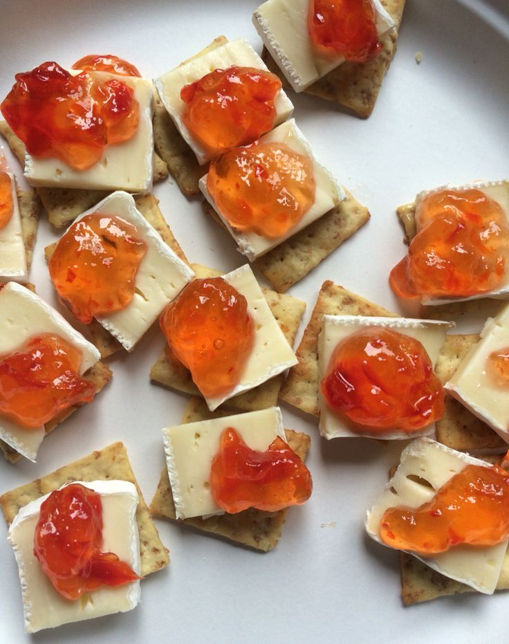 Triscuts with brea cheese and red pepper jelly.