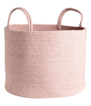 Light pink melange. Storage basket in thick jute with two handles at top. Height 11 in., diameter 13 3/4 in.