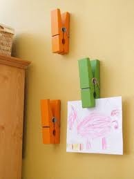 Easy DIY Art Gallery Display...buy oversized cloths pins at craft store, paint or decorate them, add magnets or use Command Strips..stick up and display!!