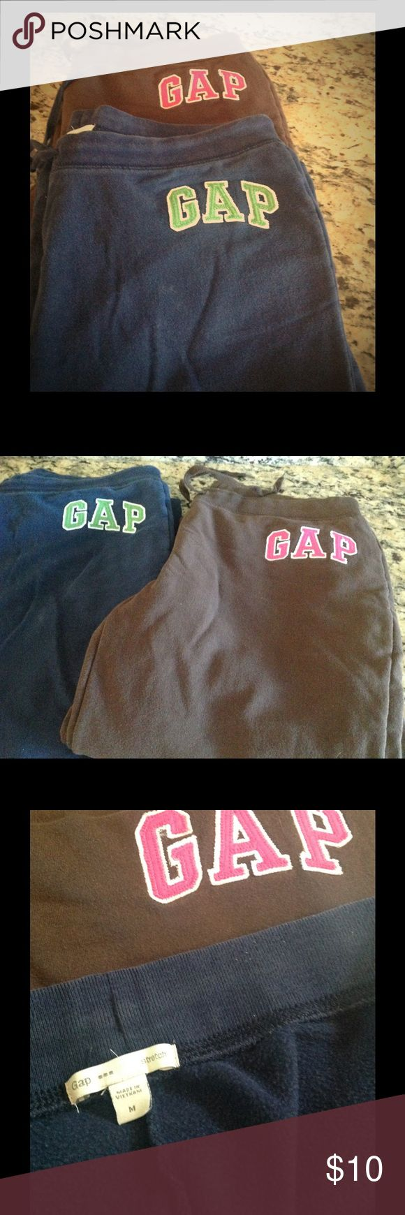 2 pairs Gap original sweatpants, Medium. ✨ 2 pairs of Gap sweatpants- navy with green GAP logo, and brown w/ hot pink logo. Great used condition. (I don't think the brown ones have ever been worn). Great price🎉. Sized medium, true to size. GAP Pants