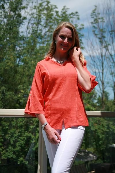 Soft light-weigh cotton perfect for summer. 3/4 split sleeve ladies Sheri top with v neck