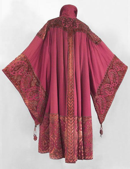 Worth, 1910.  With a circular cut, the spectacular coat is smooth across the shoulders, falling to the hem in deep folds. Jean-Philippe Worth's Persian-style border design has larger-than-life botehs in a reverse pattern—an exceptional realization of the Orientalism aesthetic.