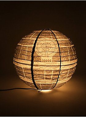 """That's no moon! It's the Death Star Paper Lantern Floor Lamp, ready to liven up your next party or give you the coolest bedroom worthy of a Sith Lord. Plug in a Death Star anywhere you choose! This Death Star Paper Lantern Floor Lamp is a 24"""" sphere which can be switched on using an in-line foot toggle. It is a great gift for anyone that loves the Dark Side.<div><ul><li style=""""list-style-position: inside !important; list-style-type: disc !important"""">24"""" diameter</li><li…"""