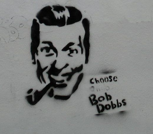 """Bob Dobb in picture - The Church of the SubGenius is an organization who parody religion, conspiracy theories and pop-culture in general. The church asserts that it was established in the 1950s by salesman J. R. """"Bob"""" Dobbs. However, it actually began in 1979 upon release of a flyer. Upon publication, it quickly gained acclaim from groups in the underground culture with particular acceptance on college campuses. It later gained attention through the underground music scene and via the…"""