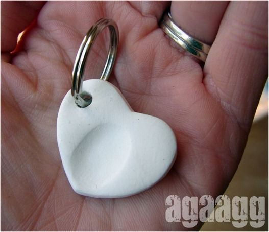 press little fingers into sculpting clag to make a fingerprint keychain or charm.