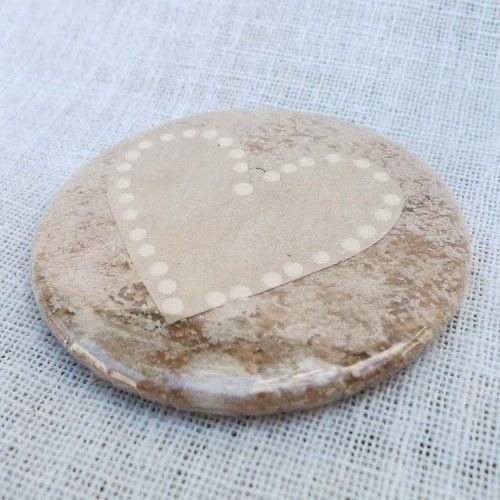 Small round fridge magnet.  Metal back plastic cover over front. Containing hand painted/crafted recycled round tea bag.