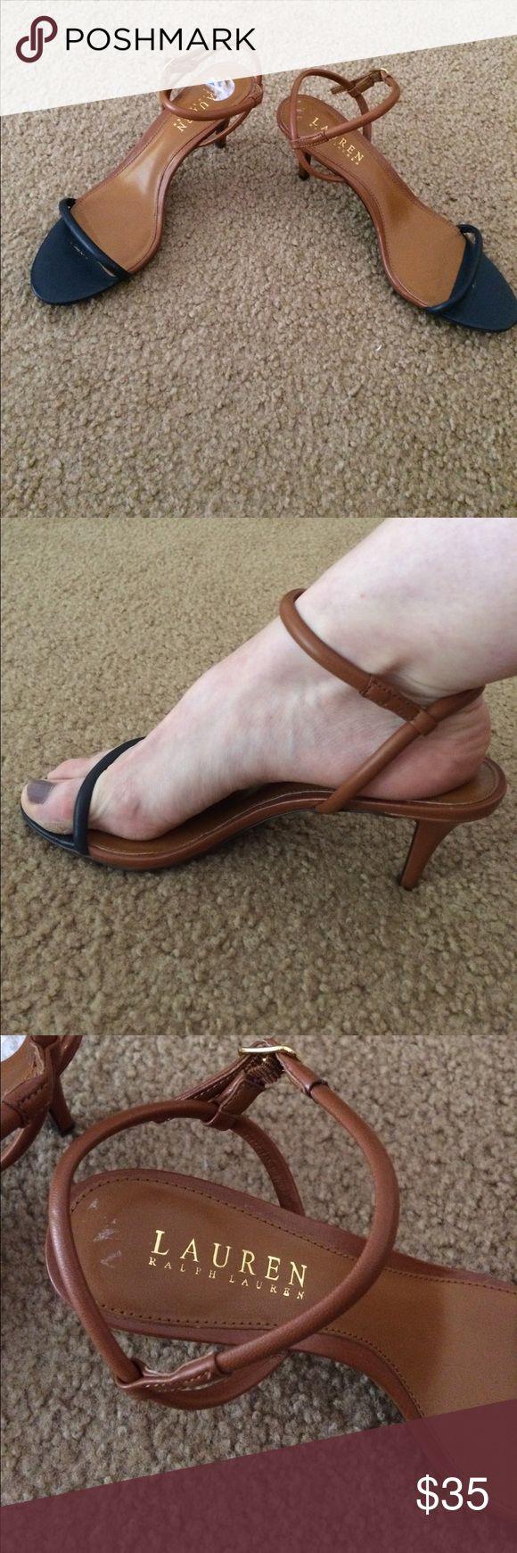 Tan and Navy Strappy Heels Classy heels by Lauren Ralph Lauren. Only flaw is residue from sales sticker, not visible when wearing. 3 inch heel. Runs just a little small. Fits between a 6 and 6.5 Lauren Ralph Lauren Shoes Heels