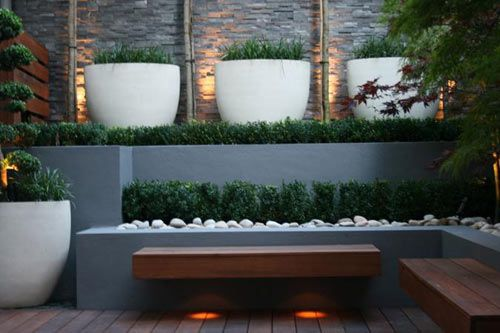 Love the colour of the raised beds and the plastered finish.  Also really like the integrated bench