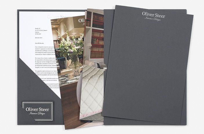 Luxury presentation folder with die-cut letterhead and business card holder and inner pocket for brochure and case study cards.