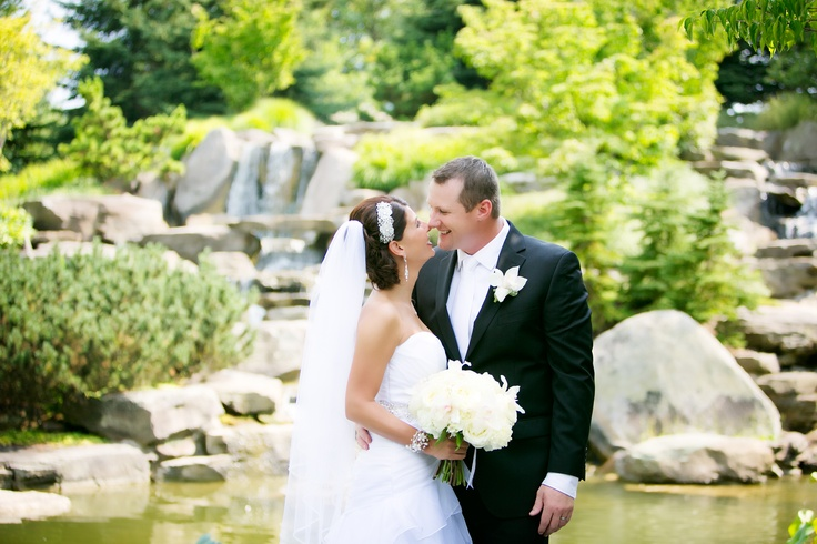 Bride and Groom wedding photos at Meijer Gardens Waterfall. (Photo by Emily Rae Photography)