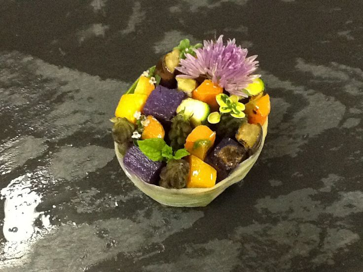 Grilled veggies ....the way I served it. Violet potatoes, eggplat, zucchine, squash, asparagus spears aromatic herbs and spring onion flower