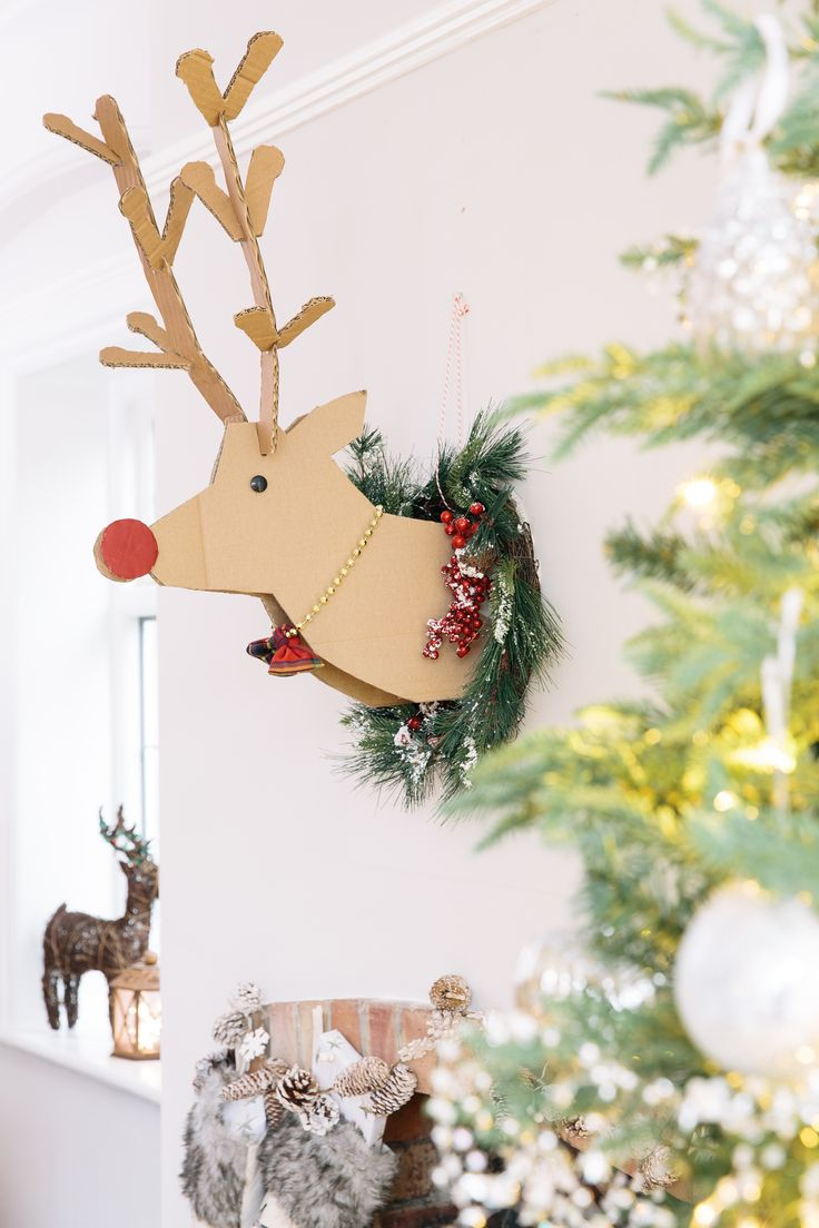 If you're buying a wreath, or you already have one, here's a cute way to add a little reindeer magic to it. And a handy reminder that Santa's on his way....