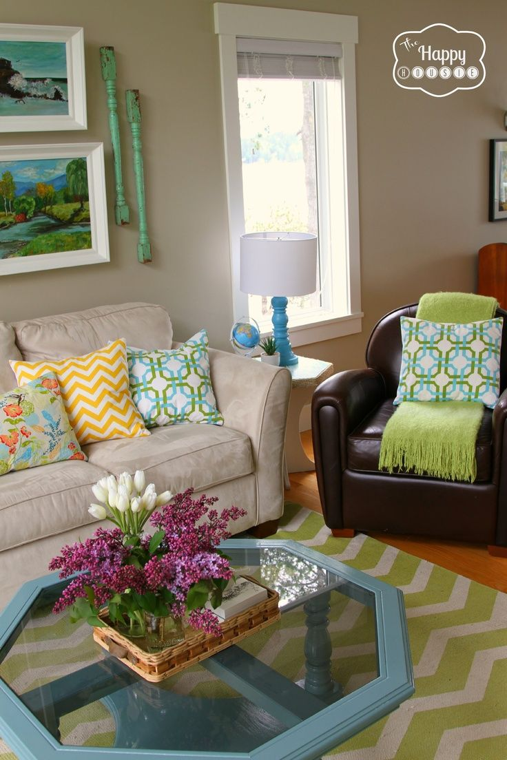 Living room colorful (neutral on walls and furniture but accents of fun color!)