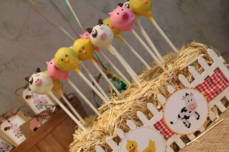 Barnyard Themed 1st Birthday Party- farm animal cake pops displayed in a bale of hay!
