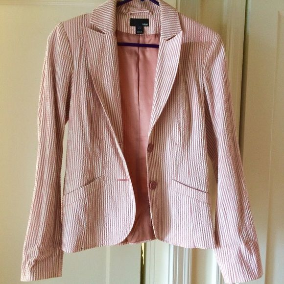 Pink and white H&M seersucker blazer Super cute pink and white seersucker blazer from H&M.  Pink satin lining, great for Spring!  Very lightly worn, in excellent condition. H&M Jackets & Coats Blazers