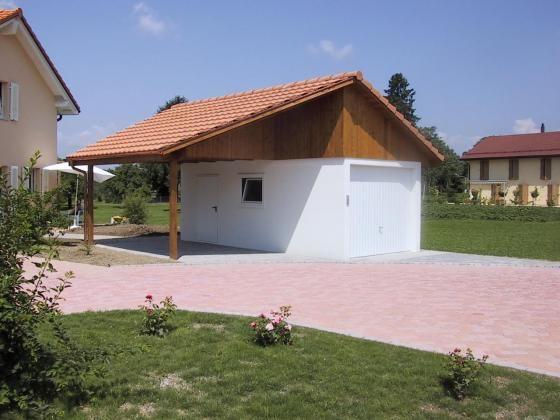 Garage préfabriqué avec fenêtre et porte de service, toit à 2 pans y compris abri latéral