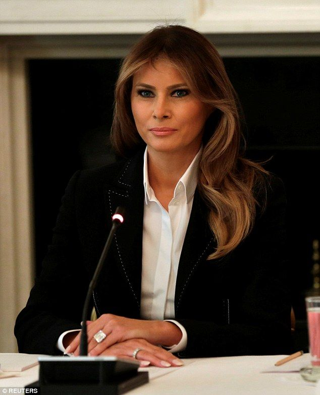Sticking with the classic: Melania Trump donned a white button-up and a classic black blazer during a roundtable discussion at the White House on Thursday