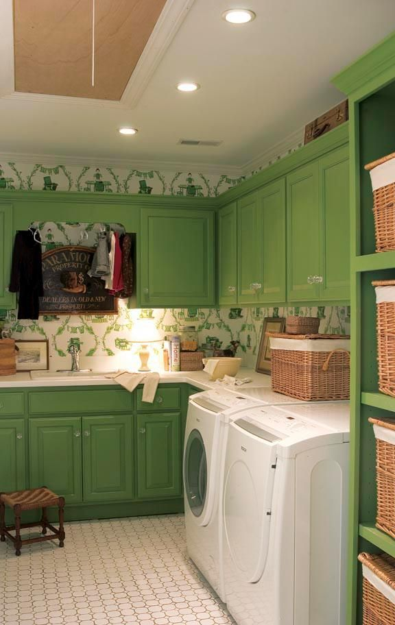 Laundry room with kelly green cabinets -- Nell Hill's