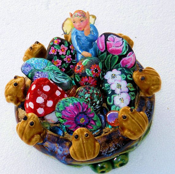 Frog rock flower bouquet Is a loaded little hand painted rock garden with   fairy ,and rock flowers that are movable for your personal touch