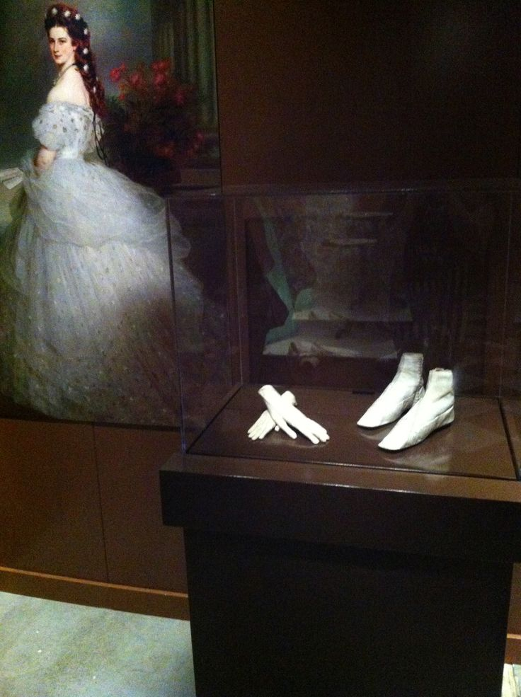 """Empress Elisabeth of Austria's shoes and gloves. From the Bata Shoe Museum's """"Fashion Victims: The Pleasures and Perils of Dress in the 19th Century"""" exhibit."""