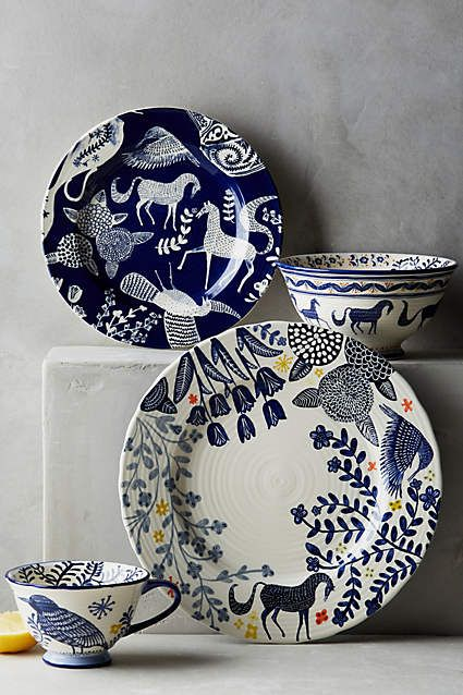 Anthropologie EU Saga Tablewear Collection. Magical horses and mythical birds from the pages of a Scandinavian folktale are brought to life in vibrant indigo.