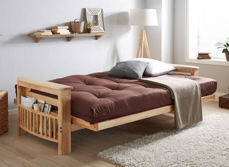 Our Houston Sofa bed is a unique and well-crafted addition to any guest bedroom or home. Made from solid wood, this comfortable sofa bed features foot end storage space for your guests' books or magazines so they're within easy reach.