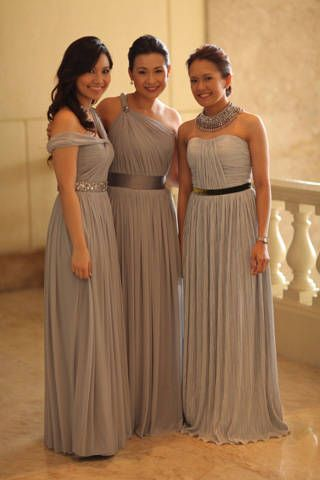 Kari's bridesmaids' stretch tulle floor-length gowns featured ruched details and chic belts in silver, gray and green | www.BridalBook.ph