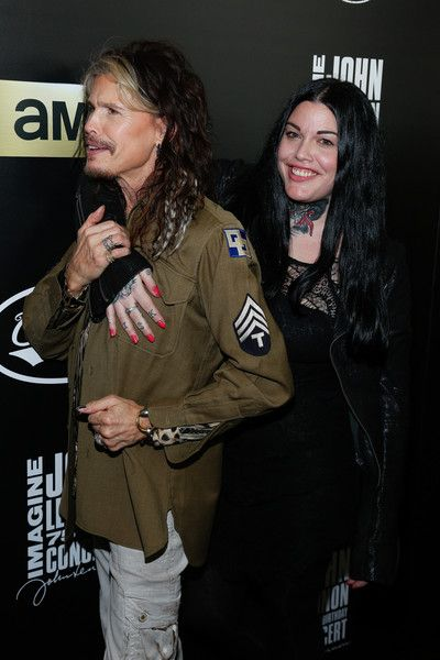 Steven Tyler Photos - Steven Tyler (L) and Mia Tyler attend the Imagine: John Lennon 75th Birthday Concert at Madison Square Garden on December 5, 2015 in New York City. - Imagine: John Lennon 75th Birthday Concert - Arrivals