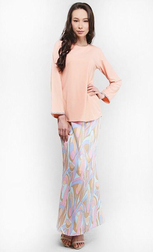 Aisya Kurung in Pastel Orange