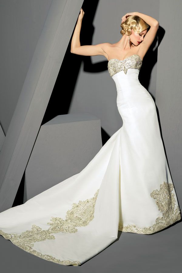 Strapless silk tulle gown, embroidered bodice, full back sweeping skirt with large embroidered train.