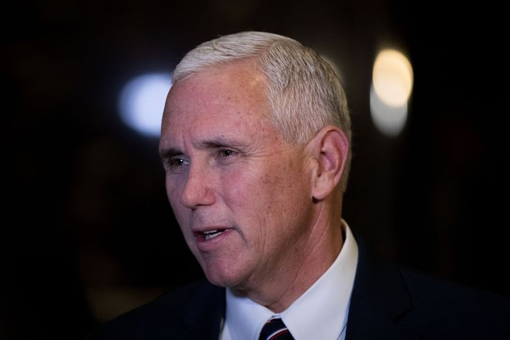 Vice President-elect Mike Pence stops and speaks briefly to reporters at Trump Tower in New York City on Nov. 18, 2016.