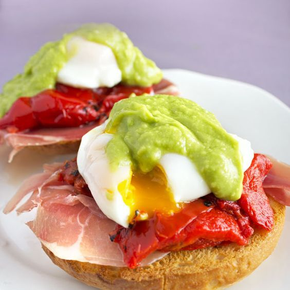 Bagel Eggs Benedict with Avocado Hollandaise Recipe Breakfast and Brunch with plain bagels, butter, prosciutto, roasted red peppers, eggs, crushed red pepper flakes, avocado, fresh lemon juice, warm water, extra-virgin olive oil, salt, pepper: