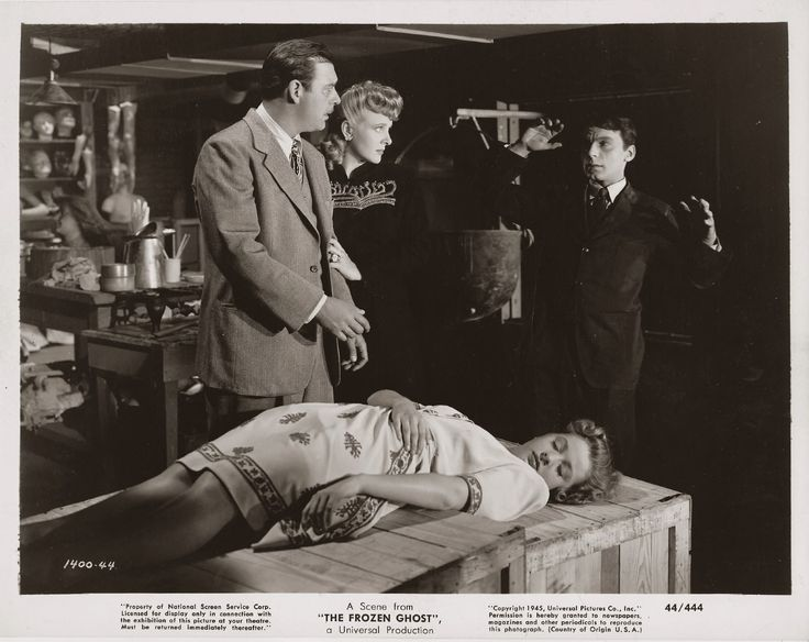 """Lon Chaney, Jr. with Evelyn Ankers, Elena Verdugo, and Martin Kosleck in the Inner Sanctum film, """"The Frozen Ghost""""."""