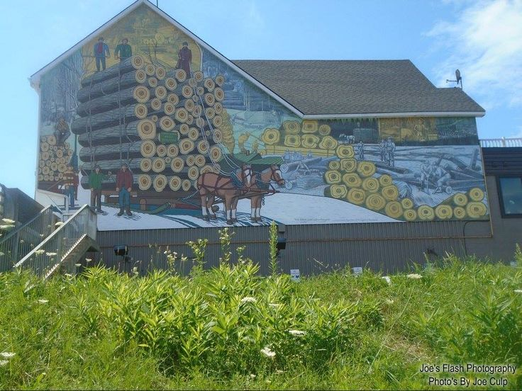 The newly refurbished Mural August 6, 2017 Parry Sound Ontario off seguin Street at the Seguin Bridge.